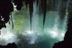 Waterfall through cave. Waterfall looking through a cave Royalty Free Stock Photography