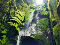 Waterfall in a cave Royalty Free Stock Image