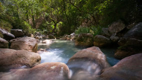 Long shutter photo shot of a flowing water stream with waterfall Stock Photo