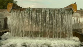 Waterfall in the city. Autumn daytime. Smooth dolly shot.  stock video