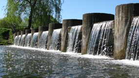 Waterfall on the city channel. royalty free stock images