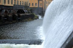 Waterfall in the city. The old industrial landscape in the middle of the town Stock Image