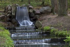 Waterfall in a city park Stock Photo