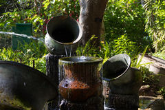 Waterfall from  clay jar Stock Image