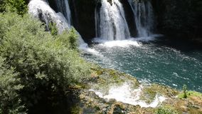 Waterfall with clean and fresh water. Nature and green forest in background stock video