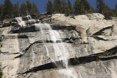 Waterfall on cliff Stock Photos