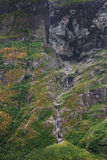 Waterfall and cliff in Geiranger fjord Royalty Free Stock Images