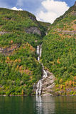Waterfall and cliff in Geiranger fjord Stock Image