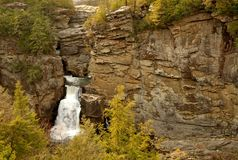 Waterfall on cliffside mountain. A waterfall on a cliff-side in rural North Carolina in Pisgah''s national forest stock photo