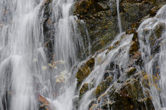 Waterfall. Close up of a waterfall against a stone wall background Stock Photo