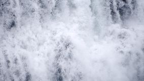 Waterfall close up slow motion background, Skogafoss Iceland. Abstract water background. Shot of real water texture for stock video