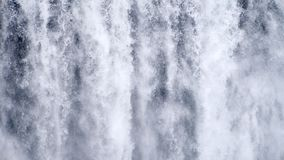Waterfall close up slow motion background, Skogafoss Iceland. Abstract water background. Shot of real water texture for stock footage
