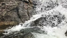 Waterfall close up slow motion. Waterfall Through Big Rocks close up in slow motion stock footage