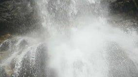 Waterfall close-up, turbulent stream splashing against the rocks. Stock footage stock footage