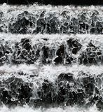Waterfall closeup. Freeze-frame shot of water droplets in a cascading waterfall Stock Photos