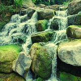 Waterfall closeup with stones and moss Stock Photo