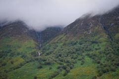 Waterfall from the clouds. Clouds caught on the mountain at Glencoe, Scotland Stock Images