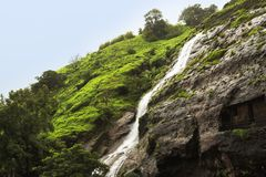 Waterfall in cloudy weather in Maharashtra, India.  stock photos