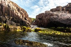 Waterfall on the coast of Barents sea, Arctic ocean, Kola Peninsula, Russia