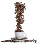 Waterfall of coffee beans in a coffee cup Stock Images