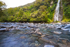 Waterfall with the cold water and rocks Stock Images