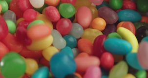 Waterfall of colorful candies stock footage