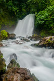 Waterfall in Costa Rica Jungle. Slow shutterspeed of a waterfall in a central American rainforest royalty free stock photography