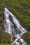 Waterfall in countryside. Scenic view of waterfall on forested mountainside Stock Photography