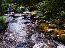 Waterfall in countryside. Scenic view of river and rocky waterfall in countryside Royalty Free Stock Photo