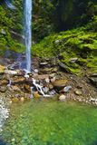 Waterfall in countryside. Scenic view of waterfall in green countryside Stock Photos
