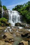 Waterfall, countryside landscape in a village in Cianjur, Java, Indonesia.  Royalty Free Stock Image