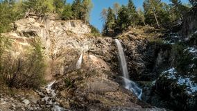 Waterfall Cover Rocks Mounatins Timelapse 4k. Timelapse of a waterfall in the Austrian mountains in 4k quality stock footage