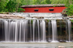 Waterfall and Covered Bridge Royalty Free Stock Photo