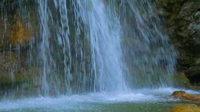 Waterfall creates splashes on the smooth surface of the river stock video