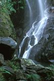 Waterfall in a Creek. A waterfall in a mountain creek Stock Photos
