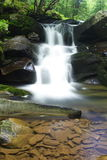 Waterfall into creek and rocks. A beautiful waterfall flows into a creek in remote West Virginia.  This is the Seneca Creek and waterfall Royalty Free Stock Images