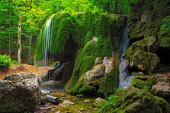 Waterfall in Crimea forest and wet mossy stone Royalty Free Stock Photography