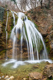 Waterfall in Crimean forest. Autumn landscape with a waterfall in the Crimean wood royalty free stock photography