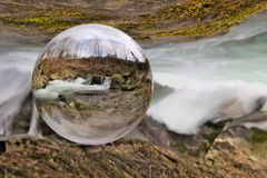 Waterfall in crystal ball stock image