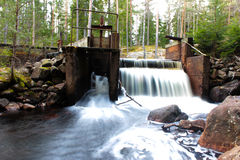 Waterfall at a dam in Sweden stock photo