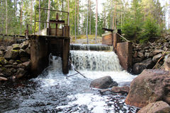 A waterfall at a dam in Sweden Stock Image