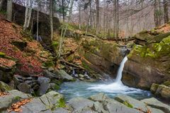 Waterfall Davir on the Turichka river. In the forest near Lumshory village of TransCarpathia, Ukraine. wooden bridge above the stream. beautiful autumnal stock images