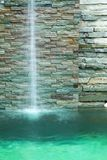 Waterfall decorate in the pool Stock Photography