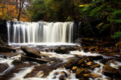 Waterfall Deep in the Autumn Forest Royalty Free Stock Photography