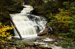 Waterfall Deep in the Autumn Forest Stock Images