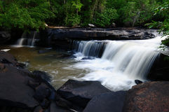 Waterfall in deep forest. In soft stream Royalty Free Stock Image