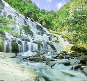 Waterfall in deep forest Stock Images