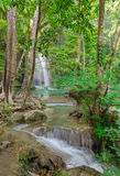 Waterfall in Deep forest at Erawan Stock Photo