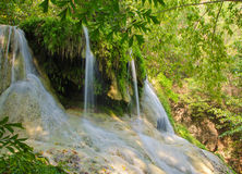 Waterfall in Deep forest at Erawan Stock Image