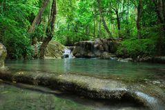 A waterfall in a deep forest in Erawan National Park. royalty free stock photography